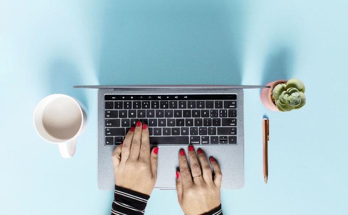 hands-on-keyboard-blue-background